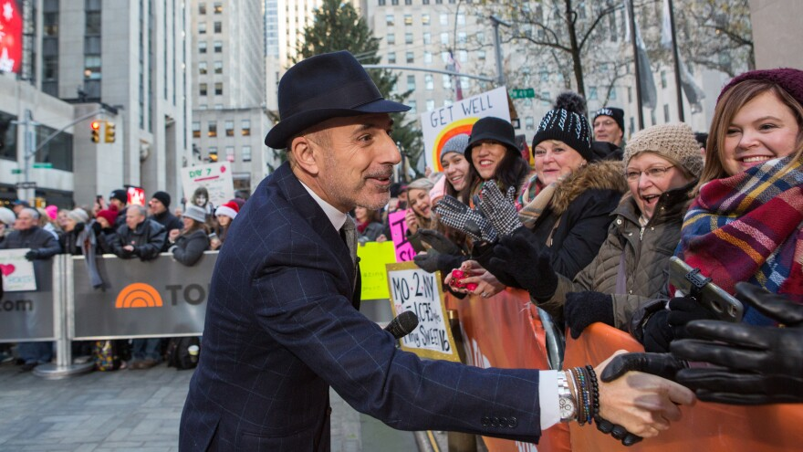Longtime <em>Today</em> host Matt Lauer greets people in the crowd on Monday. He is the latest high-profile media figure to be accused of sexual misconduct.
