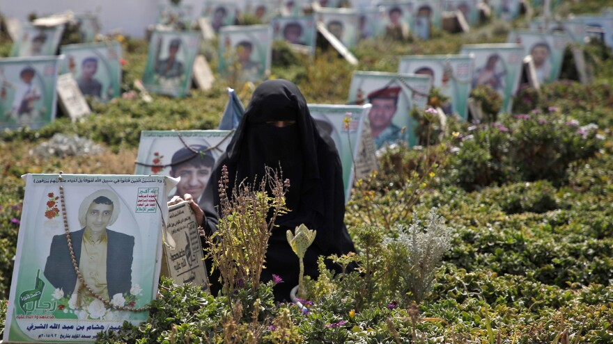 A Yemeni woman visits the grave of a relatives killed while fighting in the country's civil war on 'Martyrs Day' in the capital Sanaa, on Feb. 9.