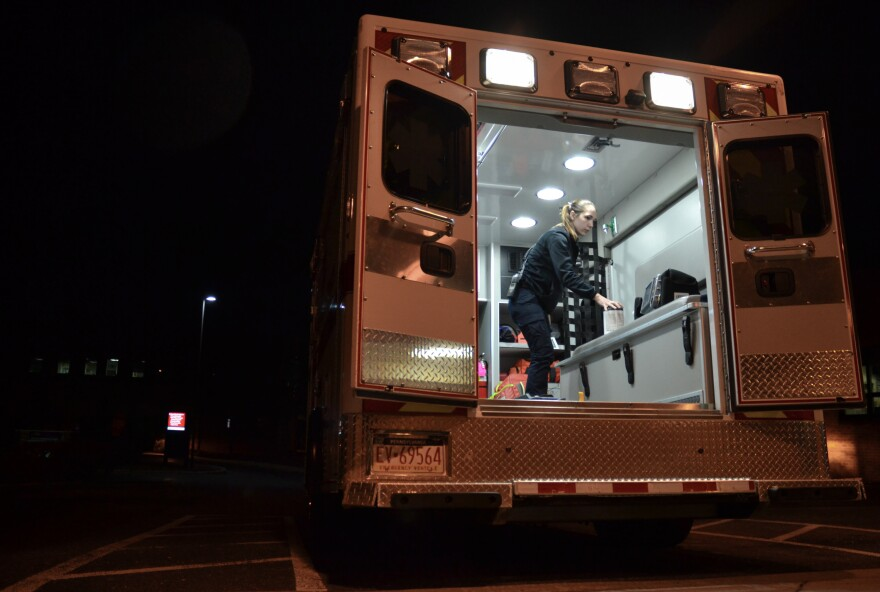 Emergency medical technician Justine Berry with Susquehanna Township EMS in Harrisburg, Pa., cleans an ambulance with antimicrobial wipes after a patient has been removed. EMS directors say more cleaning supplies and protective equipment will be vital if the coronavirus becomes widespread.