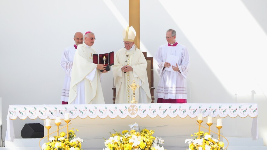 Pope Francis celebrates Mass on Tuesday at Zayed Sports City in Abu Dhabi. His three-day trip to the United Arab Emirates marks the first time a pontiff has ever visited the Arabian Peninsula.