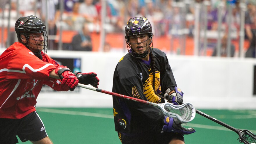 Iroquois Nationals lacrosse player Lyle Thompson (right) in the World Game in 2015.