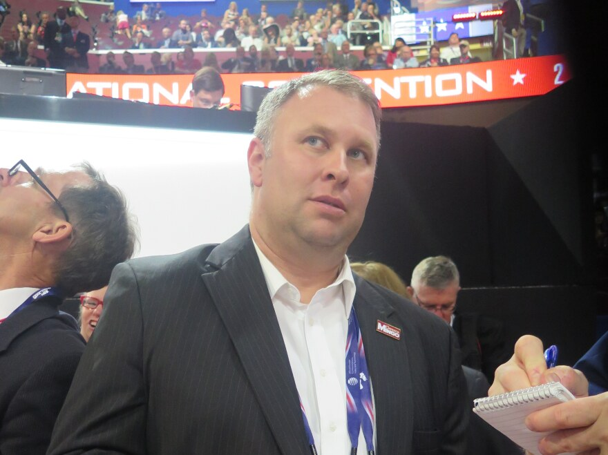 Ohio Republican Party Chair Matt Borges looks up at a video while on the floor at the Republican National Convention in Cleveland in 2016. Borges expressed reservations about Trump, but voted for him.