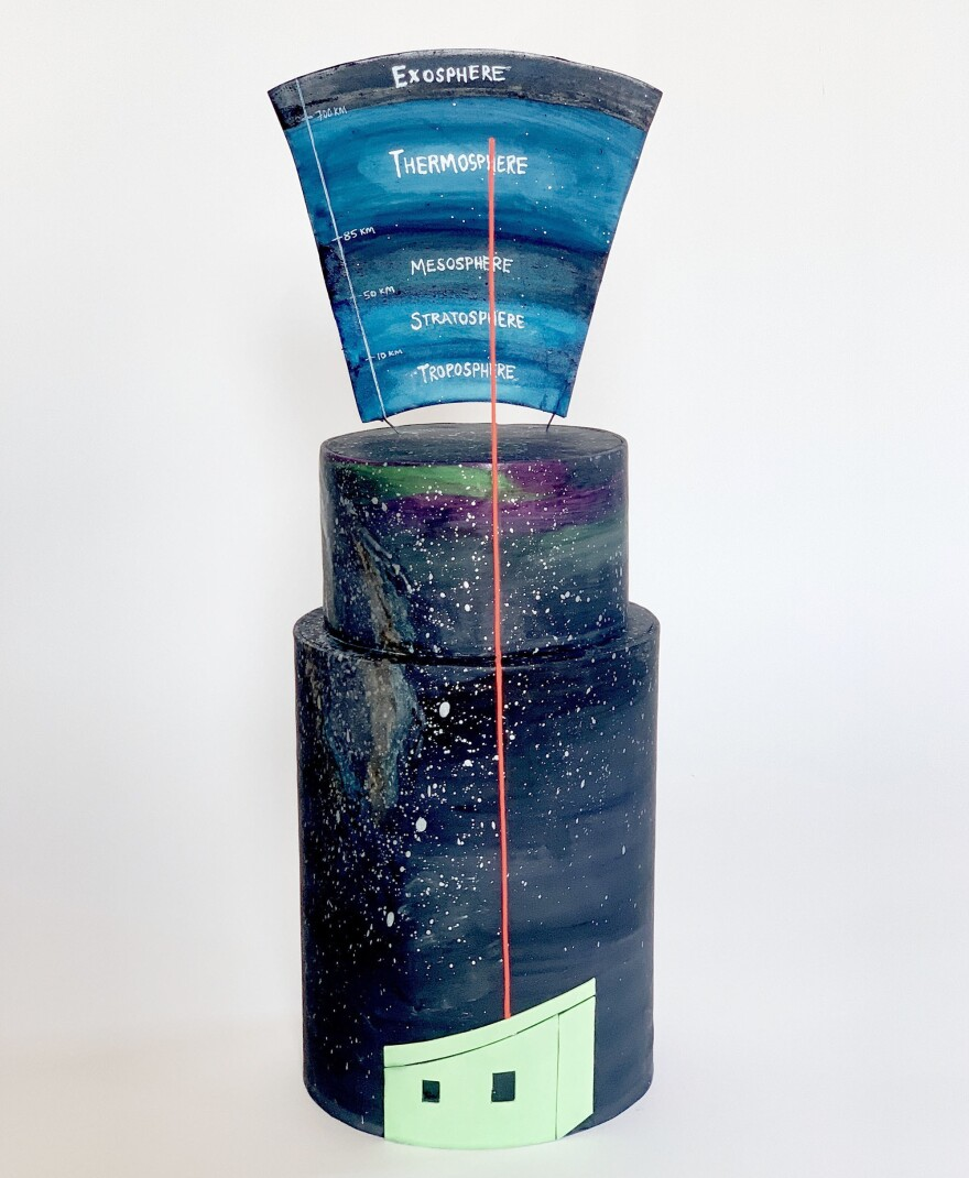 McAdoo says this cake is an homage to atmospheric scientists who have continuously operated equipment at Arrival Heights for more than 11 years — a full solar cycle. Their team shoots pulsed lasers into the sky to measure density, temperature and wind speed in the uppermost atmosphere, aided by the 24 hours of darkness during the Antarctic winter.