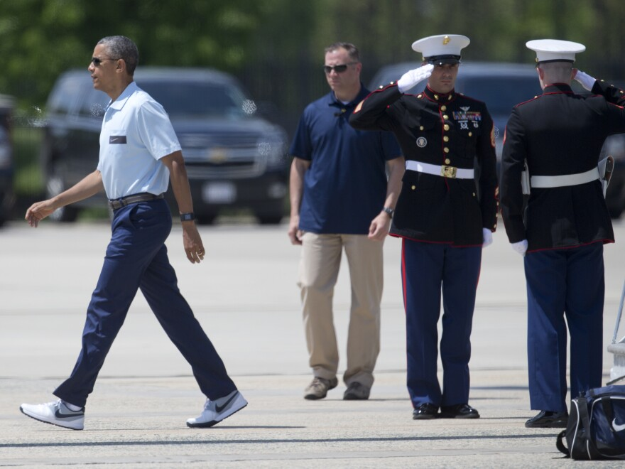 President Obama walks away from Marine One in his Nikes on Sunday. He heads to Nike Headquarters later this week.
