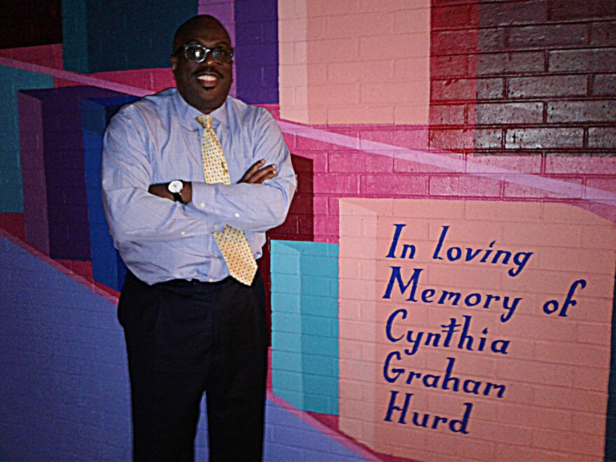 A mural dedicated to Cynthia Graham Hurd, at the library she ran for 16 years, just blocks from her home. Her brother Malcolm Graham stands next to the dedication.