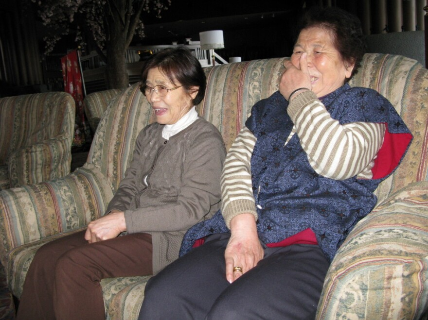 Tei Taro (left) and Kiyoko Abe are widows whose houses were swept away in  the coastal town of Yamada. Though the government suggests  relocating devastated towns elsewhere, the two women say they cannot imagine living anywhere  else.