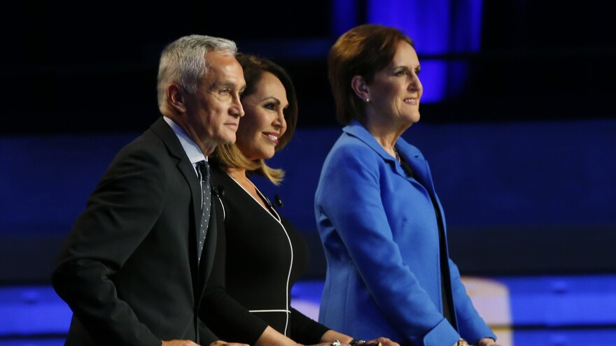 TV network Univision says its journalist Jorge Ramos has been released after being held against his will by Venezuelan President Nicolás Maduro in Caracas, Venezuela. In this photo, Ramos, with journalists Maria Elena Salinas (center) and Karen Tumulty, were moderators at a Democratic presidential debate in 2016.