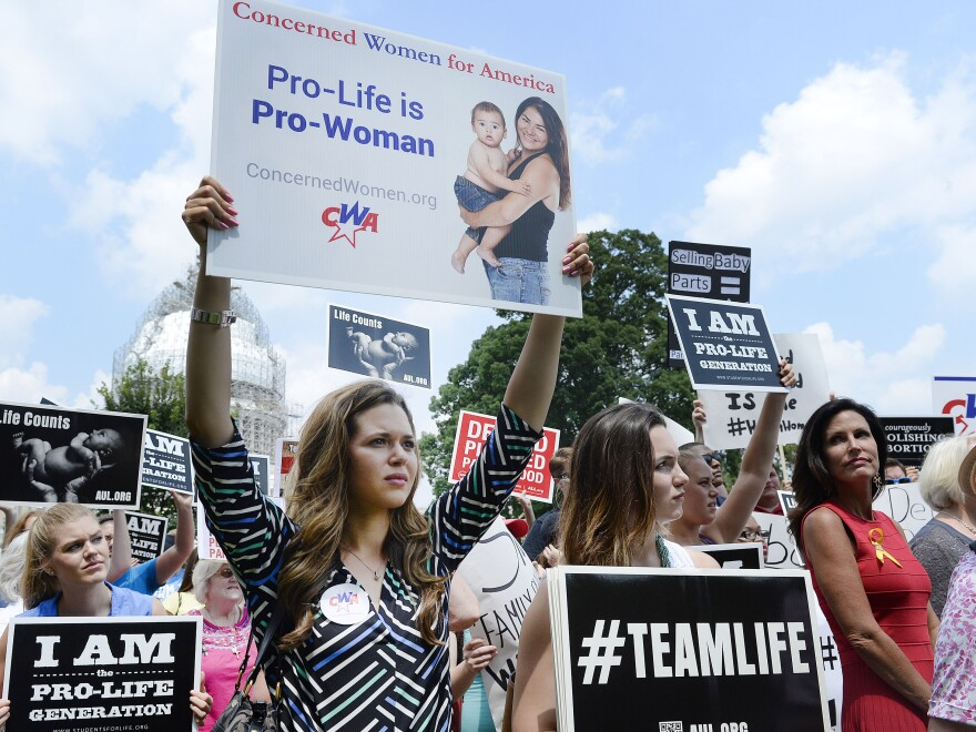 Anti-abortion activists hold a rally opposing federal funding for Planned Parenthood in front of the U.S. Capitol on July 28 in Washington, D.C.