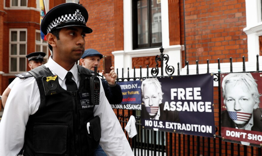 British police officers stand on duty outside the Embassy of Ecuador in London on May 20. Assange was arrested last month after being pushed out the embassy, where he had been living since 2012.