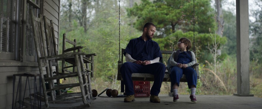 Justin Timberlake (left) and Ryder Allen star as Eddie and Sam in the new movie <em>Palmer </em>on Apple TV+.