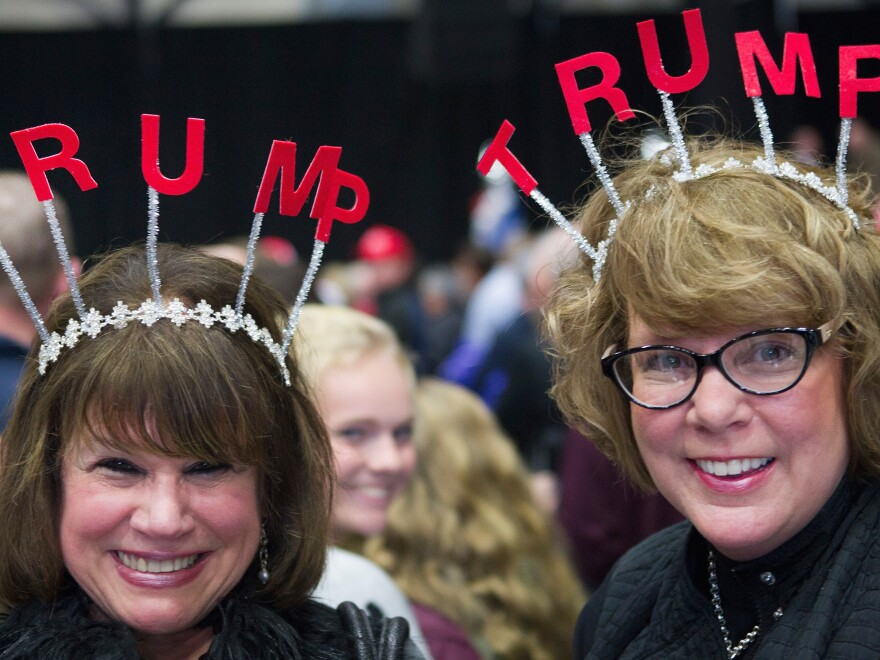 Two excited Trump supporters wait for the start of a campaign event on Monday in Grand Rapids, Mich.