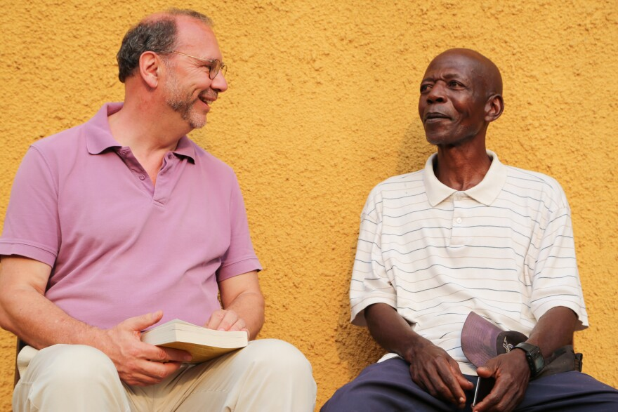 Dr. Peter Piot (left) meets with Sukato Mandzomba, a nurse who contracted Ebola during the 1976 outbreak. Mandzomba now runs a makeshift hospital lab in Yambuku.