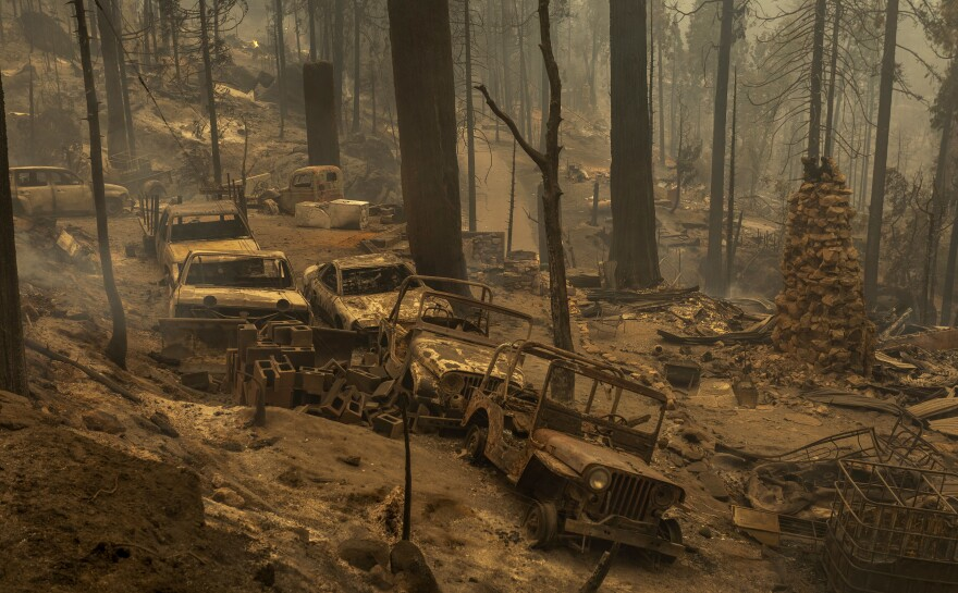 A community of forest homes lies in ruins Tuesday in the Meadow Lakes area after the Creek Fire swept through near Shaver Lake, Calif.