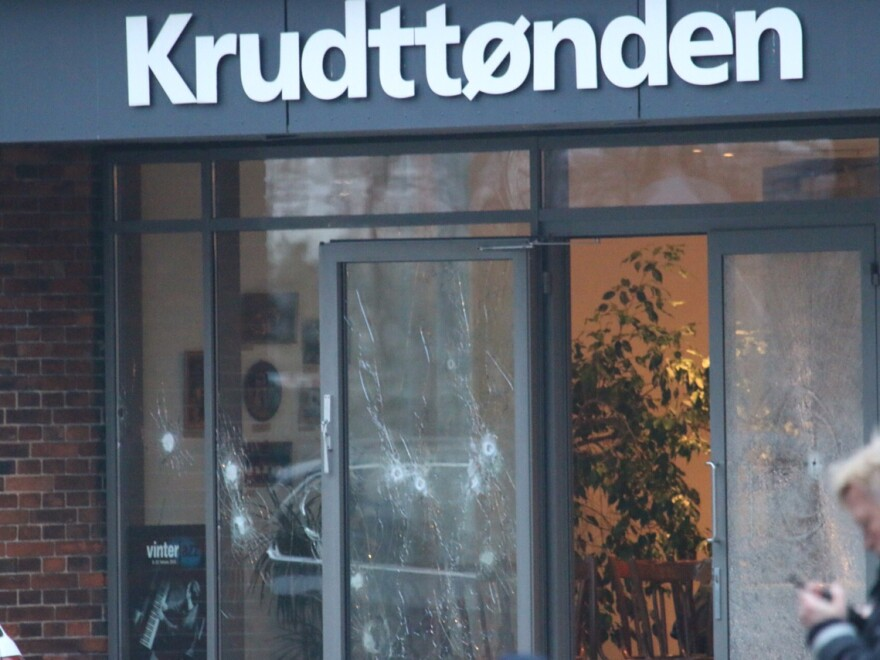 Damaged glass is seen at the site of a shooting in Copenhagen on Saturday. Shots were fired near a meeting in the Danish capital that was attended by controversial Swedish artist Lars Vilks.