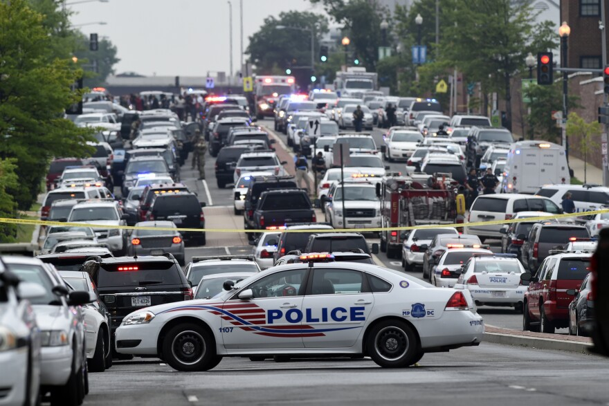 Police vehicles block off a road near the Washington Navy Yard in Washington, D.C. A lockdown is underway at the Navy Yard campus after a report of an incident.