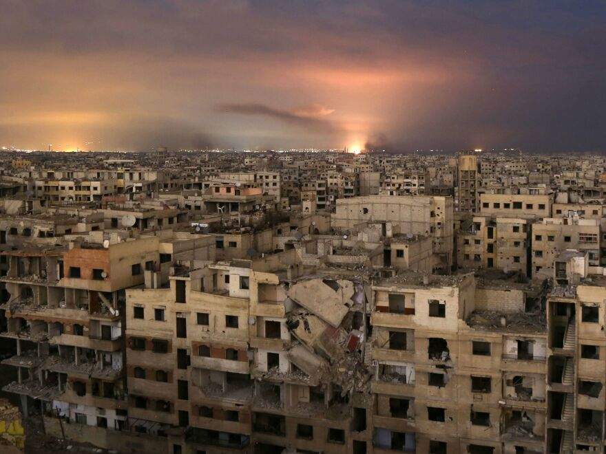 Smoke billows after a Syrian government airstrike on the besieged Eastern Ghouta region, on the outskirts of Damascus, late Friday. On Saturday, the U.N. Security Council approved a 30-day cease-fire in Syria.