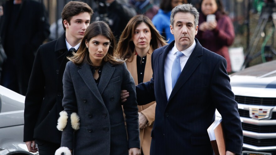 Michael Cohen (right) arrives with his family at federal court for his sentencing hearing Wednesday in New York City. Cohen was sentenced to three years in prison after guilty pleas to a number of political and financial crimes.