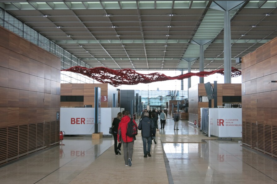 Tour groups walk through the halls of the unfinished airport. The tours cost about $11 per person.