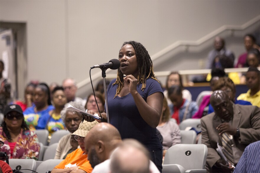 Bree Holmes addresses St. Louis school board members during a special meeting Thursday at Vashon High School.