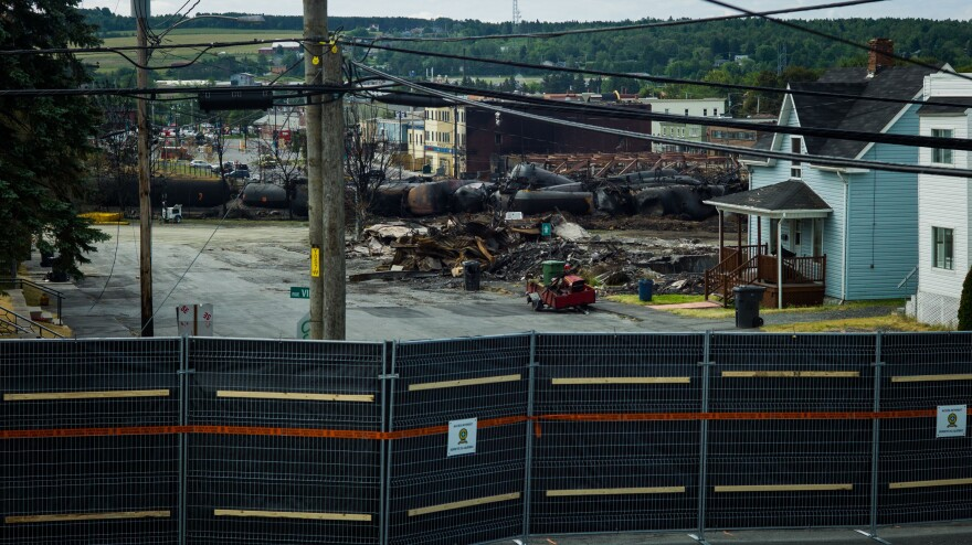 The railway company whose train derailed and exploded in Lac-Megantic, Quebec, last month can no longer operate in Canada. An image shows the scene one week after the disaster.