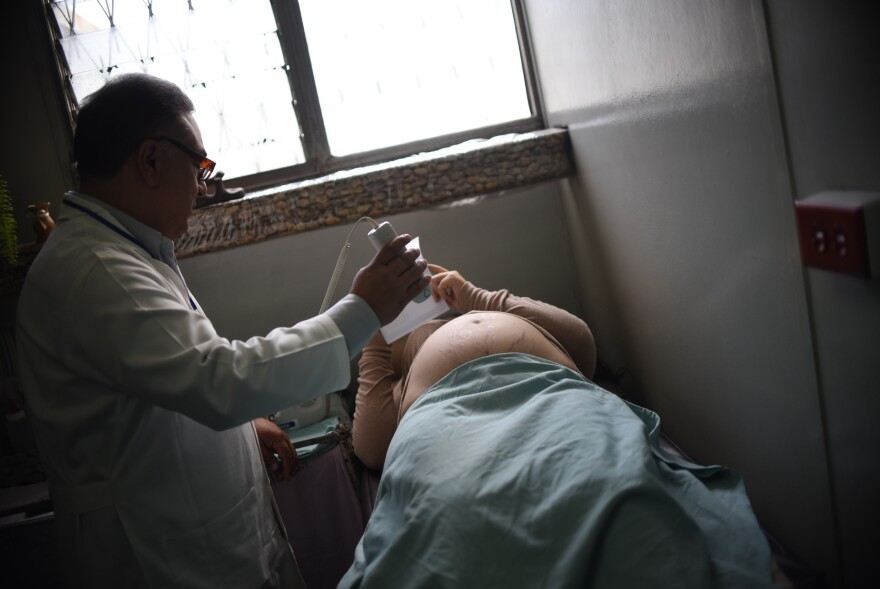 A pregnant woman gets an ultrasound to monitor for the birth defect microcephaly, in Guatemala City last month.