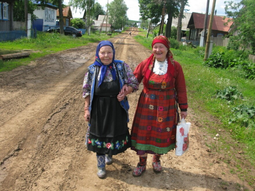 """Elizaveta Zarbatova (left), who walks with Alevtina Begisheva, is the oldest member of the group at 84. She was widowed in 1957 when her husband was  electrocuted on the job.                           """"After I lost my husband, I received some kind  of gift – the ability to compose music,"""" she says. """"The music comes from the heart. The suffering  comes right from my heart."""""""