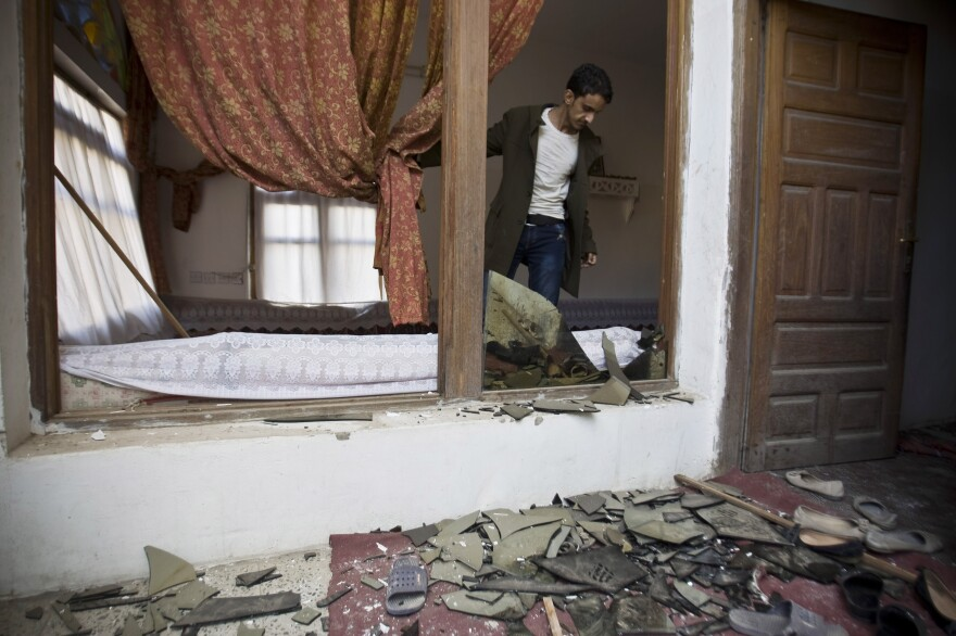 On Saudi Arabia's southern border with Yemen, there is another uprising, where Shiite rebels linked to Iran, known as Houthis, recently swept into the capital, Sanaa. Here, a Shiite Houthi man stands inside his house after a bomb explosion in Sanaa, Yemen, on Monday.