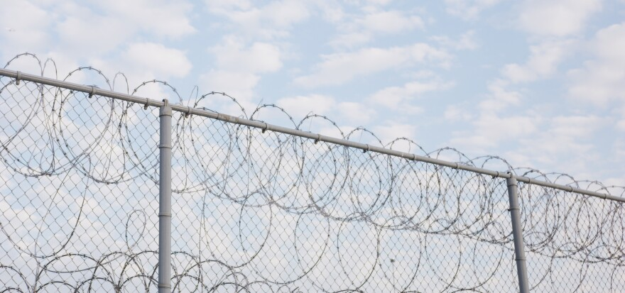 Photo of fence outside Utah State Prison in Draper, Utah.