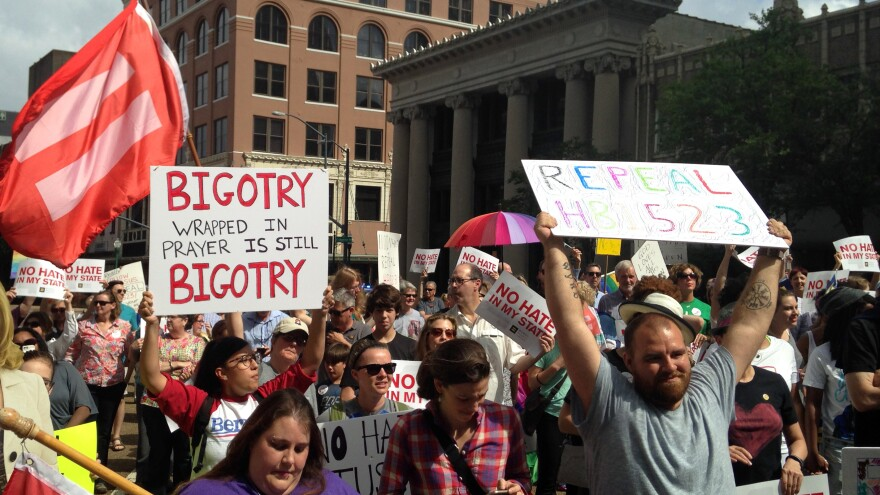 Protesters march on May 1, seeking repeal of a Mississippi law allowing religious groups and some private businesses to deny services to same-sex couples, transgender people and others. A federal judge ruled the law unconstitutional late Thursday.