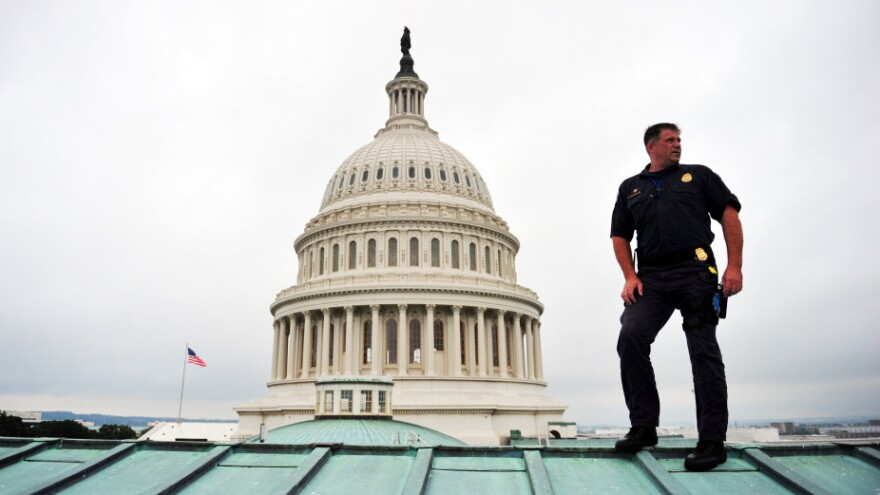 A U.S. Capitol policeman performs a security sweep of the Capitol Dome and roof ahead of President Obama's speech to Congress on Thursday. The U.S. is spending more than $70 billion on homeland security this year, up from $20 billion a decade ago.