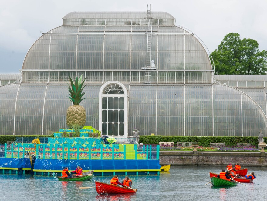 Boaters on the Palm House pond at London's Kew Gardens. Bompas and Parr's pineapple island is visible in the background.