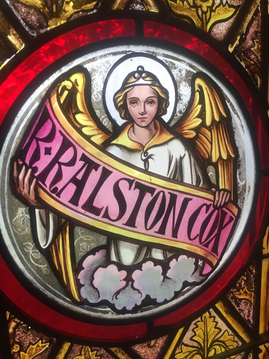 A stained glass window in St. John Chrysostom church honors Ralston Cox, the young seminarian whose dream it was to establish it. He drowned before he could see it built in 1851.