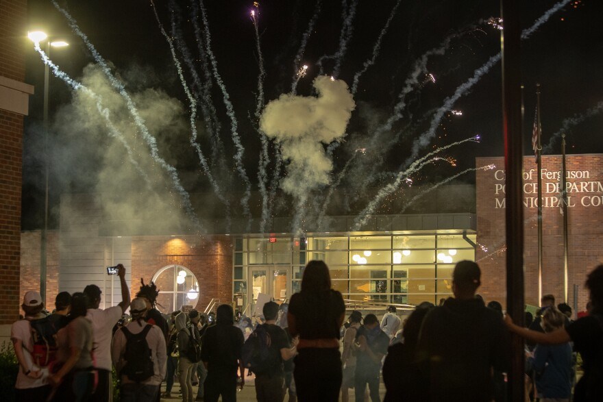 Protesters used a sustained volley of fireworks against police Saturday night at a protest in downtown Ferguson May 30, 2020. Police eventually fired smoke grenades back.