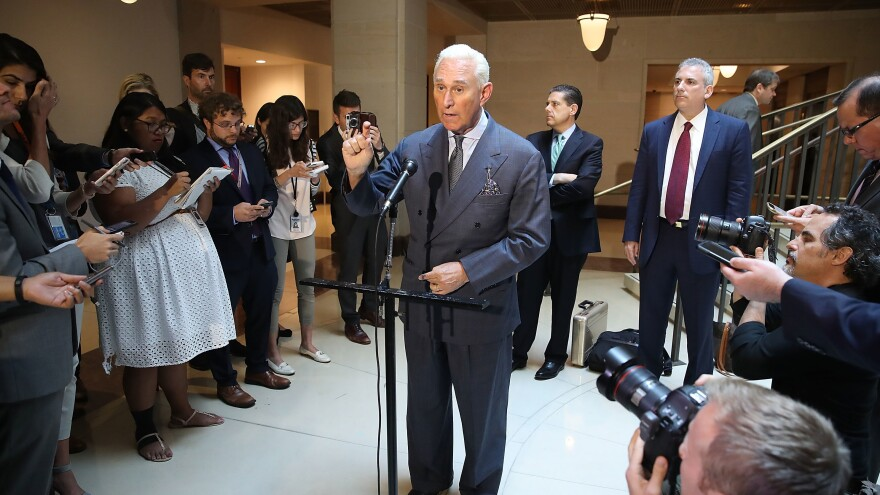 """Roger Stone, a longtime ally of President Trump, speaks to the media after appearing before the House Intelligence Committee during a closed door hearing last September. On Sunday, Stone bemoaned the """"excesses and partisanship"""" of Robert Mueller's investigation."""