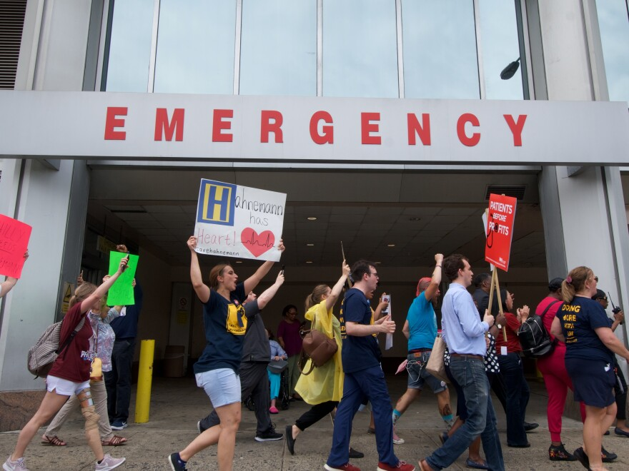 Philadelphia residents, hospital workers, and local politicians protested the imminent closure of Hahnemann University Hospital at a rally on July 15, 2019. In March 2020, city leaders tried but failed to strike a deal with the hospital's new owner to reopen the facility for an expected coronavirus surge.