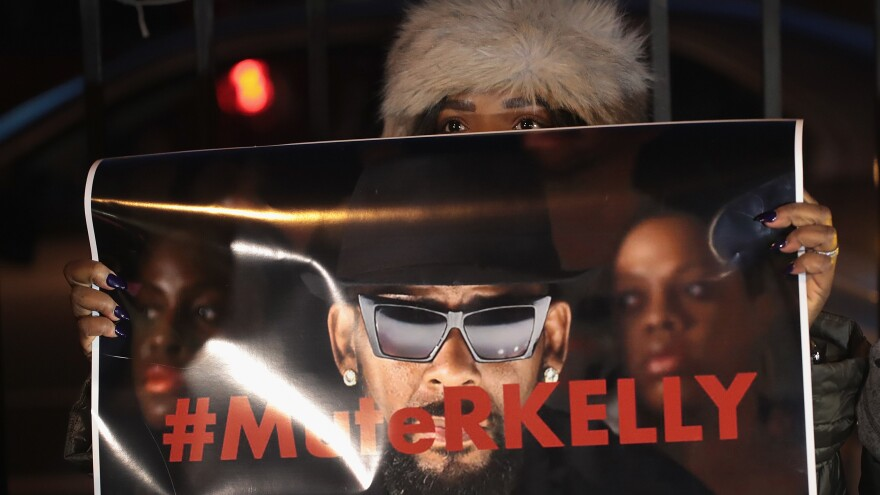 Demonstrators gather near the studio of singer R. Kelly to call for a boycott of his music on Jan. 9, 2019 after allegations of sexual abuse against young girls were raised on the Lifetime docuseries <em>Surviving R. Kelly.</em>