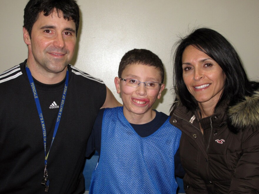 Jake Finkbonner, shown with his father, Donny, and mother, Elsa, nearly died after contracting a flesh-eating bacterium. His family and friends prayed for a miracle, and now the Vatican has declared that his recovery was considered a miracle by the church.