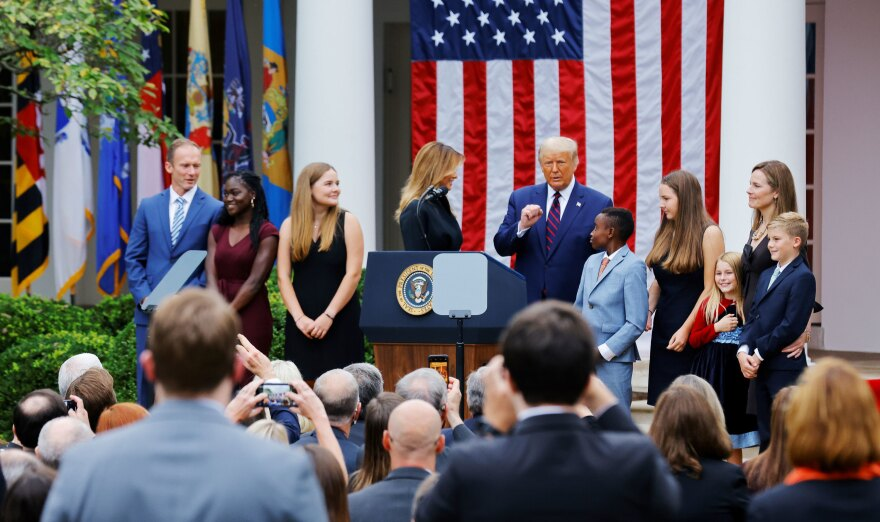President Trump poses with Supreme Court nominee Amy Coney Barrett and her family at an event to announce her as his nominee on Saturday.