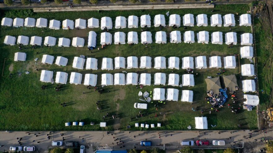 An aerial photo depicts a makeshift camp in Thumane, northwest of Albania's capital, Tirana. The country was in national mourning Wednesday as emergency workers continued to pull bodies from the ruins of buildings gutted by the earthquake.