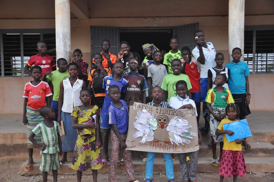 Students in the English club in the village of Gouandé, Benin, learned about the holiday of Thanksgiving from Peace Corps volunteer Abby Reilly, then wrote what they were thankful for on feathers and pasted them on a poster of a turkey that she'd made.