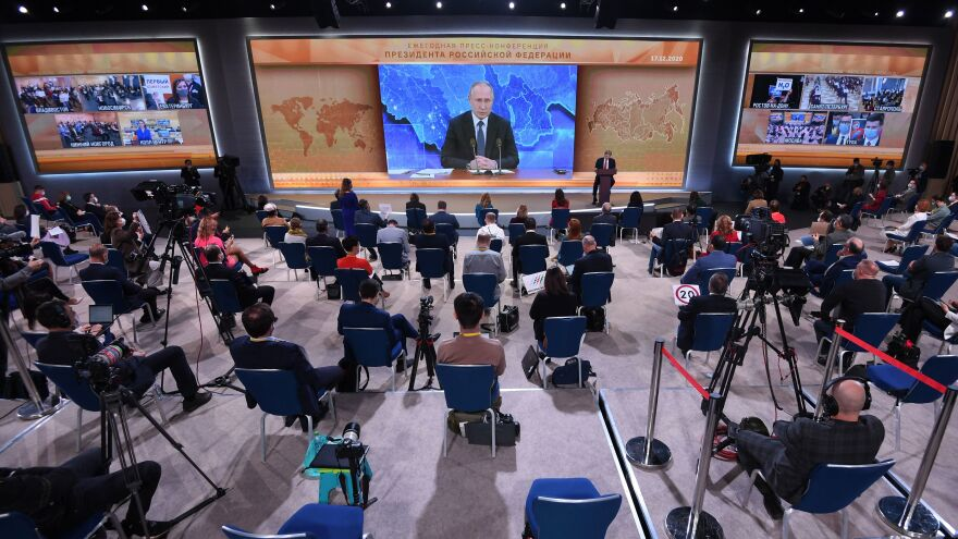 Journalists gather in front of a big screen in Moscow for Russian President Vladimir Putin's annual news conference Thursday, which underwent some changes amid the coronavirus pandemic.