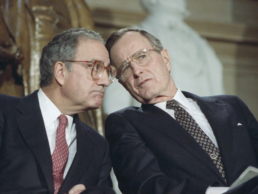 President George H.W. Bush, seen with Senate Majority Leader George Mitchell, D-Maine, in 1991, was punished at the ballot box for compromises that produced a budget-reduction act in 1990.