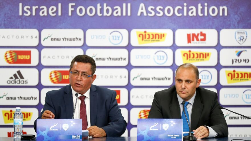 Ofer Eini and Rotem Kamer, president and CEO of the Israeli Football Association, respectively, address the media Wednesday in the town of Ramat Gan, east of Tel Aviv. The men announced that the organization will file a formal complaint to FIFA against the Palestinian Football Association.