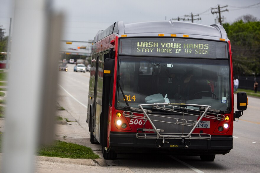 A Capital Metro bus displays a public health message during the COVID-19 pandemic.