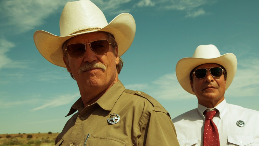 Jeff Bridges (shown with Gil Birmingham) plays an aging Texas ranger investigating a series of small-town bank robberies in <em>Hell or High Water.</em>