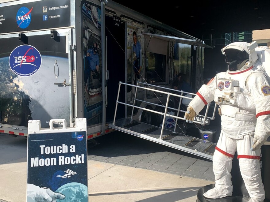 NASA's Destination Station exhibit features a moon rock, videos and a spacesuit for selfies.