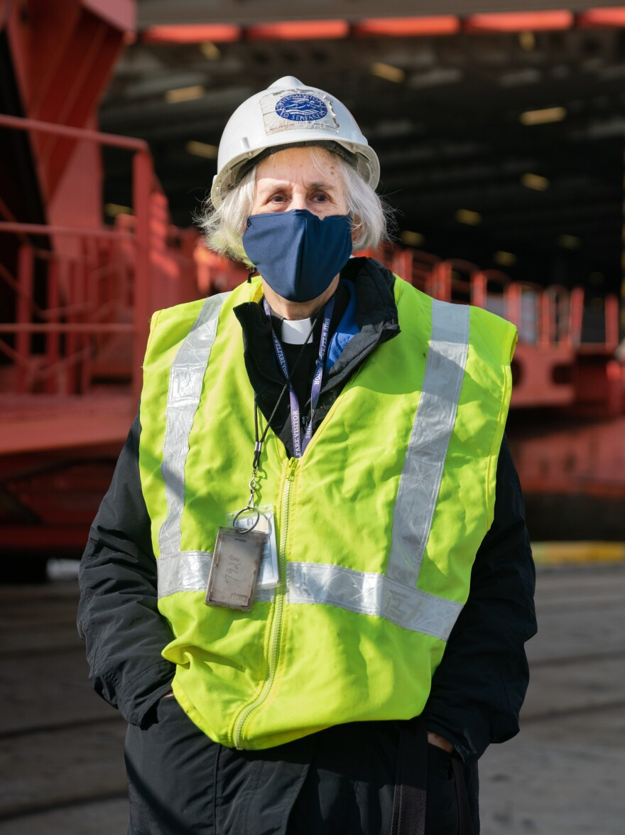 The Rev. Mary Davisson, executive director and port chaplain of the Baltimore International Seafarers' Center, delivers personal items to seafarers who are not allowed off ships.