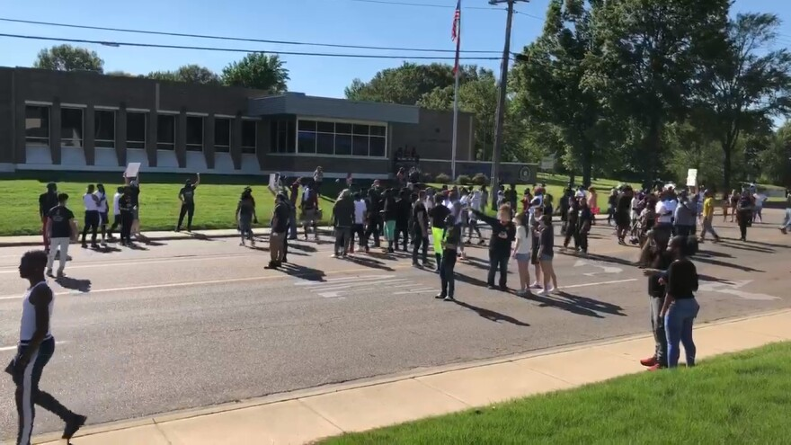 On Sunday, these protestors gathered outside of the Jonesboro Police Department headquarters in response to multiple killings of people of color by the hands of police.