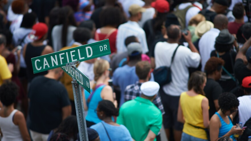 Hundreds of demonstrators gathered at the spot where Michael Brown was shot and killed. The crowd observed 4 1/2 minutes of silence, one minute for each of the 4 1/2 hours that Brown's body lay in the street before being taken away.