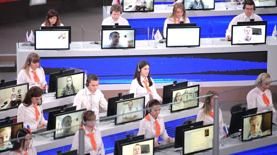 Operators take live calls from across Russia. The call center received some 2 million messages, including 1.3 million phone calls.